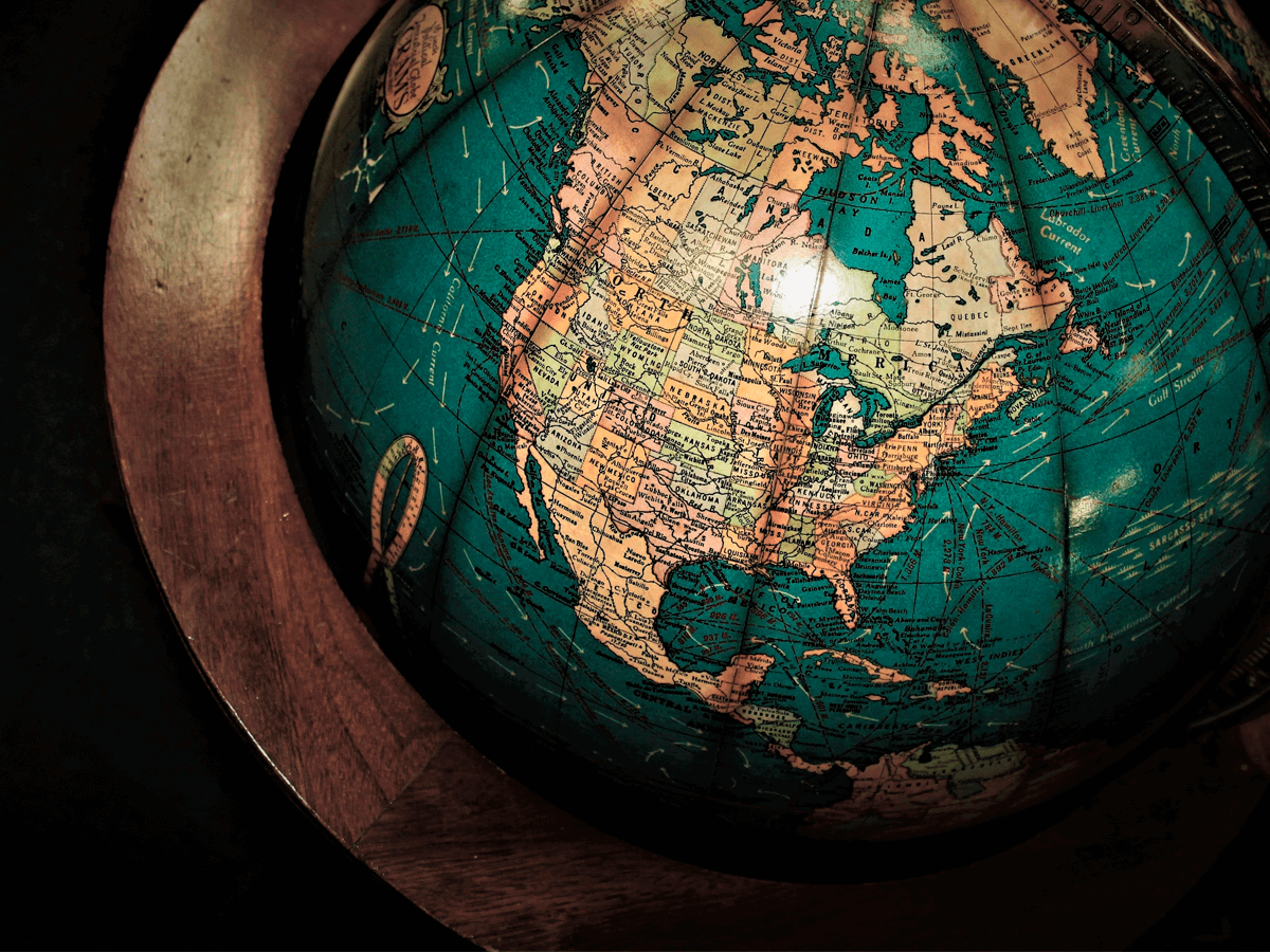 A globe with the map representing Talkdesk growth as a scaleup.
